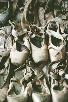 A collection of old ballet shoes.