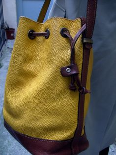 Vintage bucket bag circa 1980 yellow vynil and by lesclodettes, $55.00