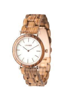 The model LEONA is an amazing accessory for sunny days. The light zebranowood perfectly fits the white marble dial and the graceful rose golden bordering. Thanks to the extra thin design, the watch is light as a feather and comfortable to wear. Shops, Watch Display, Wooden Watch, Seiko, Link Bracelets, Gold Watch, Bracelet Watch, Modeling, Quartz
