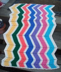 The Crooked Ripple   Thick, bold chevron ripples make this colorful afghan a delight