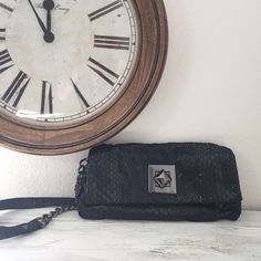 """Kenneth Cole Reaction handbag Black snakeskin print shoulder bag. Plenty of room for essentials for a night on the town, and where is an inner zip pocket for your valuables/small/items. Worn once, perfect condition with no stains or flaws I can see.18""""drop, 10x6"""" Kenneth Cole Reaction Bags"""