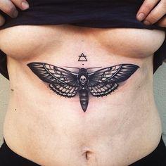 deaths head moth tattoo plus transcend symbol