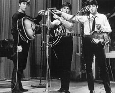 John Lennon, George Harrison and Paul McCartney at the Playhouse Theatre, London: May 21, 1963