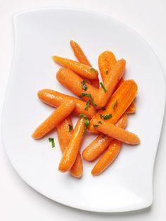 Baby carrots get a sweet honey-ginger glaze in this simple side dish recipe.
