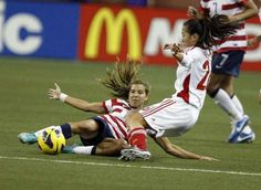 Tobin Heath makes a tackle against Chinese defender Haiyan Wu, Ford Field, Detroit, Dec. 8, 2012. (Kirthmon F. Dozier/Detroit Free Press)