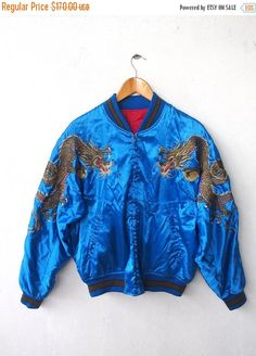 ON SALE 25% UKAJAN Japan Vintage 1980's Embroidery Dragon All Over Yakuza Souvenir Blue Satin Jacket Size L Korean War by CaptClothingVintage on Etsy https://www.etsy.com/listing/262419401/on-sale-25-ukajan-japan-vintage-1980s