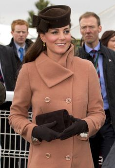 The Duchess of Cambridge attends day 4 of the Cheltenham Festival at Cheltenham Racecourse on March 15, 2013, wearing a brown hat by Sylvia Fletcher of James Lock and Co.