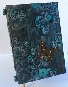 Mixed media art journal with rusted butterfly.