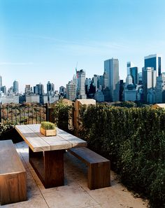 Donna Karan's New York penthouse features a heavy wood table and benches, and an unobstructed view of Central Park and the city skyline. Photographed by François Halard, Vogue, June 2005.