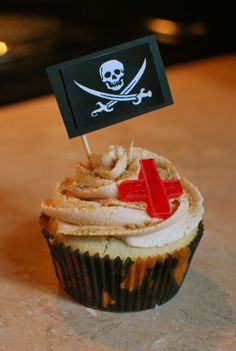 pirate cupcakes with gold coin in the center.