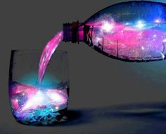 This gorgeous concoction is called Aurora Jungle Juice. It's pink in natural light, but when viewed under black light it glows aquamarine. It's made of gin/vodka, Rose's Mojito Passion/pink lemonade and gin. Incredible