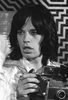Mick holdong a poaroid like my Mom's.