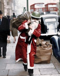 Father Christmas wearing a tin helmet walks along Regent Street, London, with a bag full of presents - from Life Magazine, December 23, 1940    Merry Christmas to everyone out there following me, and a happy New Year! Stay safe.