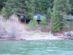 Coeur d'Alene Lake, Rockford Bay, below Black Rock Golf Club, 85' frontage, 5 bedrooms, 2 baths, 1868 sq ft daylight rancher, great sandy beach, 2 slip dock, paved road, remodeled recently, very good condition. Pioneer Title Prelim in document section.