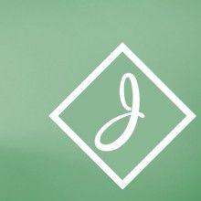 cursive in a box on green J
