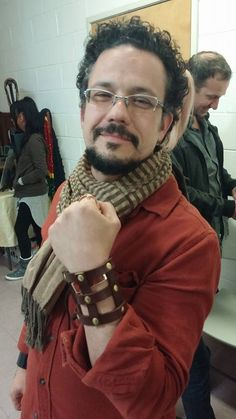 We shared a table with accessories brand Necrosarium at the Cannibal Flower art show event.  Here a customer is wearing our leather wristcuff.