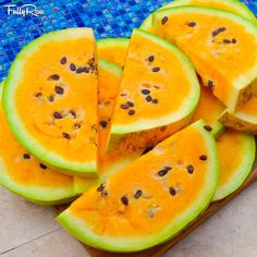 They almost look like GIANT FullyRaw pizza slices!  Yellow watermelon from Rawfully Organic Co-op!