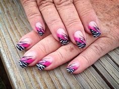 Half-Tips done in Pink & Black with White Zebra Stripes! Plus a touch of Silver Glitter for some added Sparkle!  For more of my fabulous nail art designs visit my Facebook page or website: www.jessicasnaildesigns.webs.com