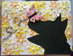 Butterfly, Dog and Flowers Birthday Card. Why are you sitting there painstakingly cutting out small stamped flowers out? Because they make the perfect background for a birthday card starring our black Lab Hank!