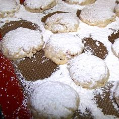 Mexican Wedding Cookies Recipe--add a hershey kiss in the middle before cooking= yummy!!!