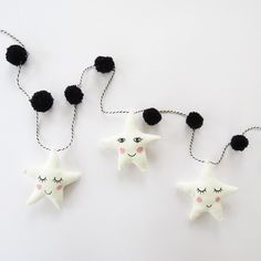 """""""Sleepy star, smiley star, sleepy star... Totally love this star garland by House of Clouds  https://folksy.com/shops/Houseofclouds"""""""