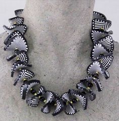 Twist necklace by Peg Gerard, handcrafted black and white polymer clay folded beads.   galleryfiveblog.com
