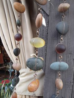 Rain Chain with rocks and sea glass...These would be fun to make!...I could use the rocks I've saved from vacations!