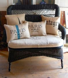 Black wicker and vintage linen cushions