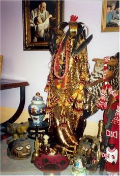 Santeria/Lukumi Orisha Shrines: Oshun (notice vulture feathers)