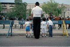 A Hasidic family looks across the police barricade placed in front of the… Crown Heights, The Crown, Hanging Out, Israel, New York City, Brooklyn, Police, Bottle, Pictures