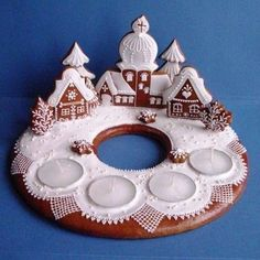 Gingerbread village with advent candles Gingerbread Village, Christmas Gingerbread House, Noel Christmas, Christmas Goodies, Christmas Treats, Christmas Baking, All Things Christmas, Christmas Decorations, Xmas