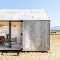 Casa Transportable house ÁPH80 by Ábaton that fits on the back of a lorry and moved by road, with cement board walls and hinged panels.