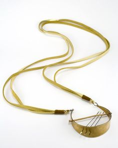 Long architectural mixed material necklace brass by betsyandiya