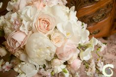 Romantic blush pink and ivory teardrop bouquet. Wedding bouquet of roses, blossom, orchids and peonies - Laurel Weddings - http://www.laurelweddings.com/blossom-wedding-flowers/