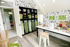 OMG! Ultimate craft room. I am pretty sure I can talk drew into letting me convert the loft :)