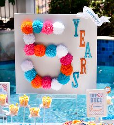 DIY a sign with a # for birthday or initial of the birthday person by sticking pom poms to a canvas or board - cute idea via Hostess With the Mostess
