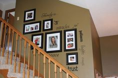 family photos going down the stairway...i really luv this idea