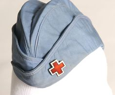 Red Cross blue garrison cap with cut-out cloisonné pin on left front flap, circa PHN still wore these hats. I remember watching every morning her putting on this hat! I admired her so much I wanted to be her. Medical Uniforms, Military Uniforms, Ww2 Women, Garrison Cap, Blood Drive, Military Fashion, Military Style, Vintage Nurse, American Red Cross