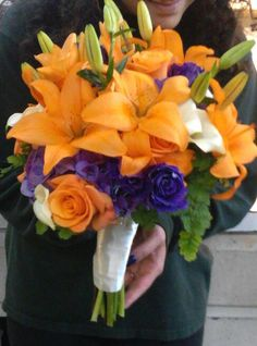Lilies, lisianthis, roses, mini calla lilies, hydrangea, and ivy bouquet