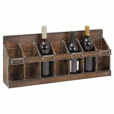 """Weathered wood wine rack with storage for 7 bottles.  Product: Wine rackConstruction Material: WoodColor: Weathered chocolateFeatures: Holds seven wine bottlesDimensions: 11"""" H x 26"""" W x 4"""" D"""