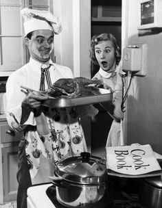 "Jack Lemmon startles his wife, Cynthia Stone, who co-stars with him on ""Heaven for Betsy,"" as he pridefully surveys his secret recipe for a great Thanksgiving Turkey -- 1952"
