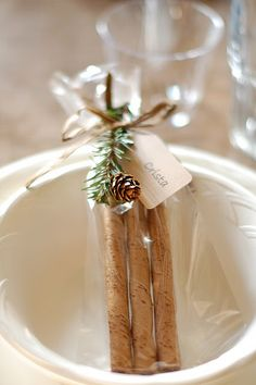Christmas Crafts : Simple Dinner Favors * Chocolate-mint rolled cookie sticks wrapped in cellophane with a sprig of faux greenery, a tiny pine-cone, and a name tag marking each place setting. Noel Christmas, All Things Christmas, Winter Christmas, Christmas Crafts, Christmas Decorations, Christmas Place, Woodland Christmas, Christmas Tablescapes, Christmas Countdown