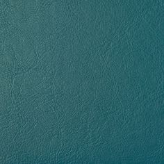 Orzan Faux Leather Upholstery Fabric Faux leather upholstery fabric in mute Teal. Suitable for Domestic and Contract upholstery.