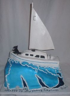 White sailboat yacht cake