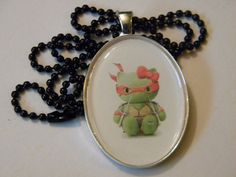 Raphael Kitty cameo necklace by WonkyTreasures on Etsy, $10.00