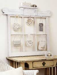 This old window makes a great display for a vintage purse collection.