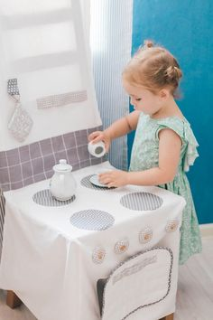 This play kitchen is a fabric cover that goes over a chair. So clever