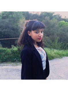 Bangs for Curly Textures - Straight Bangs (pictured: Amandla Stenberg) | allure.com