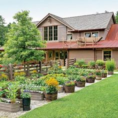 Edible Container Garden; using galvanized tubs and whiskey barrels on a gravel base