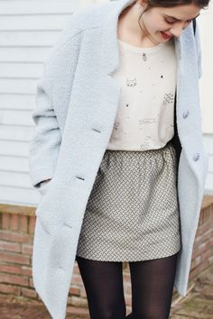 Pale blue coat + white and black patterned mini skirt +| embellished white t-shirt